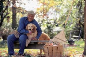 Senior Man Hugging Dog